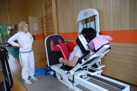SAALFELDEN, AUSTRIA - AUGUST 30: physical therapist assisting female patient on August 30, 2007 at rehabilitation center in Saalfelden, Austria. Editorial