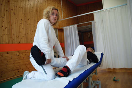 SAALFELDEN, AUSTRIA - AUGUST 30: physical therapist exercising with female rheumatism patient on August 30, 2007 at rehabilitation center in Saalfelden, Austria. Stock Photo - 8526287