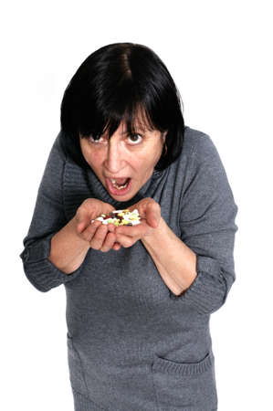 Concept shot of retired woman addicted to pills and drugs isolated on white background. photo