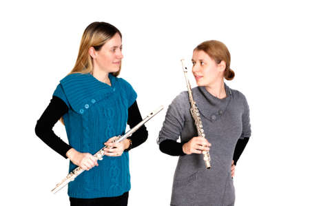 transverse: Two young women playing transverse flute, isolated on white background.