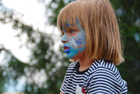 MITTERSILL, AUSTRIA - JUL 4: Children face painting at the supporting programme of the Watersports Event Erdinger Sautrogrennen on July 4, 2010 at the Zierteich in Mittersill, Austria Stock Photo - 8607850