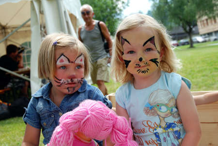 MITTERSILL, AUSTRIA - JUL 4: Children face painting at the supporting programme of the Watersports Event Erdinger Sautrogrennen on July 4, 2010 at the Zierteich in Mittersill, Austria Editorial