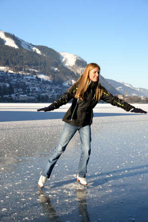 pirouette: Pirouette of young woman figure skating at frozen lake of zell am see in austria Stock Photo