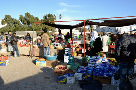 DJERBA, TUNISIA - JAN 23: People at typical traditional tunisian street market in Houmt Souk. January 23, 2010 in Djerba, Tunisia.
