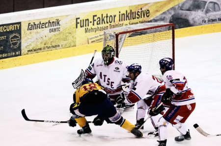 bodycheck: ZELL AM SEE, AUSTRIA - FEB 1: Austrian National League. Stefan Uhl misses with a shot. Game EK Zell am See vs. ATSE Graz (Result 4-1) on February 1, 2011, at hockey rink of Zell am See Editorial