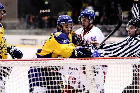 bodycheck: ZELL AM SEE, AUSTRIA - FEB 1: Austrian National League. Putnik punches Graz player. Game EK Zell am See vs. ATSE Graz (Result 4-1) on February 1, 2011, at hockey rink of Zell am See