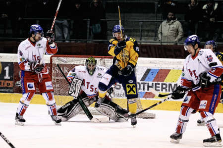 bodycheck: ZELL AM SEE, AUSTRIA - FEB 1: Austrian National League. Shot on Graz Keeper Ales Sila. Game EK Zell am See vs. ATSE Graz (Result 4-1) on February 1, 2011, at hockey rink of Zell am See