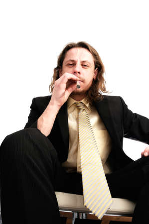 Young business man smoking weed after work photo