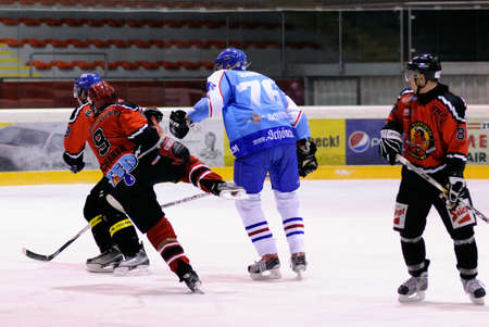 bodycheck: ZELL AM SEE, AUSTRIA - FEB 13: Salzburg hockey League. Hard hit against Scharer. Game SV Schuttdorf vs HCS Morzg  (Result 9-3) on February 13, 2011 at the hockey rink of Zell am See