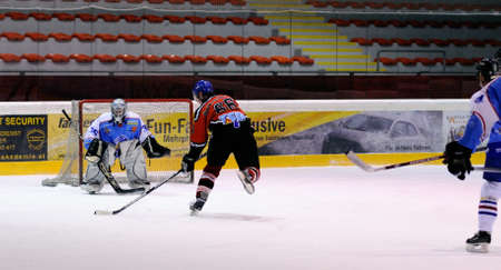 bodycheck: ZELL AM SEE, AUSTRIA - FEB 13: Salzburg hockey League. Niki Lang scores on a breakaway. Game SV Schuttdorf vs HCS Morzg  (Result 9-3) on February 13, 2011 at the hockey rink of Zell am See Editorial