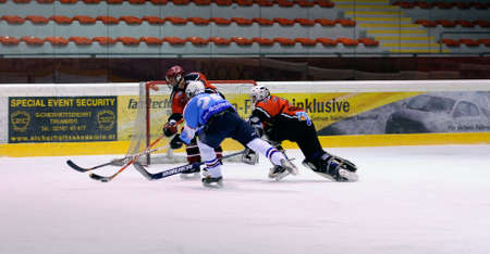 bodycheck: ZELL AM SEE, AUSTRIA - FEB 13: Salzburg hockey League. Goalie Hochwimmer dives to the net to save the puck. Game SV Schuttdorf vs HCS Morzg  (Result 9-3) on February 13, 2011 at the hockey rink of Zell am See