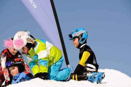KAPRUN AUSTRIA - MARCH 5: Maiskogel Fanlauf 2011. Unidentified children playing with snow at charity ski race with many celebrities in austria on March 5, 2011 at the Maiskogel in Kaprun, Austria Stock Photo - 9272106
