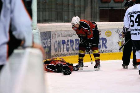 bodycheck: ZELL AM SEE, AUSTRIA - MARCH 19: Salzburg hockey League. Injured Schuettdorf player after hard hit. Game SV Schuettdorf vs Salzburg Sued  (Result 10-4) on March 19, 2011, at the hockey rink of Zell am See.