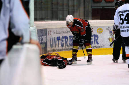 ZELL AM SEE, AUSTRIA - MARCH 19: Salzburg hockey League. Injured Schuettdorf player after hard hit. Game SV Schuettdorf vs Salzburg Sued  (Result 10-4) on March 19, 2011, at the hockey rink of Zell am See.
