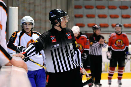 ZELL AM SEE, AUSTRIA - MARCH 19: Salzburg hockey League. Linesman trying to calm down benches after fight. Game SV Schuettdorf vs Salzburg Sued  (Result 10-4) on March 19, 2011, at the hockey rink of Zell am See.
