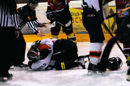 bodycheck: ZELL AM SEE, AUSTRIA - MARCH 19: Salzburg hockey League. Fight between Herbert Wierer and Salzburg player. Game SV Schuettdorf vs Salzburg Sued  (Result 10-4) on March 19, 2011, at the hockey rink of Zell am See.