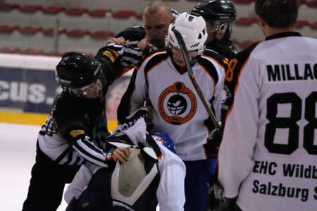 bodycheck: ZELL AM SEE, AUSTRIA - MARCH 19: Salzburg hockey League. Fight between Markus Ralser and Salzburg player. Game SV Schuettdorf vs Salzburg Sued  (Result 10-4) on March 19, 2011, at the hockey rink of Zell am See. Editorial