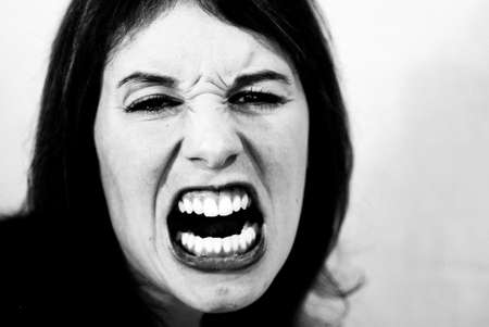 Black and white shot of mad, screaming woman.