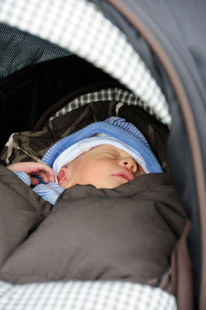 Cute new born baby sleeping in his buggy. Stock Photo - 9333878