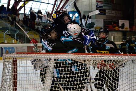 major battle: ZELL AM SEE, AUSTRIA - APRIL 30: Hockey world tournament. Bantam major final Black wings Linz (Austria) vs. Sokol-96 Kiev (Ukraine). Linz players celebrating 2-1 victory at the hockey rink of Zell am See, Austria at April 30, 2011