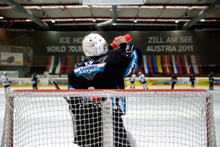 major battle: ZELL AM SEE, AUSTRIA - APRIL 30: Hockey world tournament. Bantam major final Black wings Linz (Austria) vs. Sokol-96 Kiev (Ukraine). Linz goalie Stefan Muller at the hockey rink of Zell am See, Austria at April 30 2011.