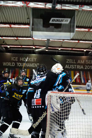 major battle: ZELL AM SEE, AUSTRIA - APRIL 30: Hockey world tournament. Bantam major final Black wings Linz (Austria) vs. Sokol-96 Kiev (Ukraine). Linz players celebrating 2-1 victory at the hockey rink of Zell am See, Austria at April 30, 2011.