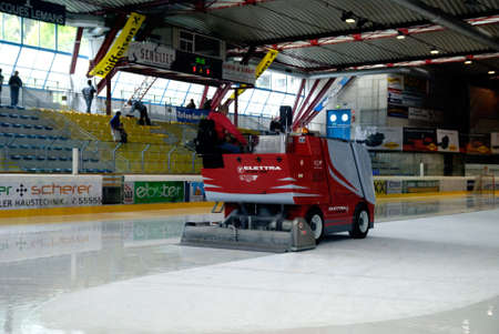 am: ZELL AM SEE, AUSTRIA - APRIL 30: Hockey world tournament. Bantam major final Black wings Linz (Austria) vs. Sokol-96 Kiev (Ukraine). Zamboni cleaning ice after the second period in the hockey rink of Zell am See, Austria in April 30, 2011.