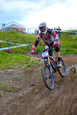 LEOGANG, AUSTRIA - JUN 12: UCI Mountain bike world cup. Neko Mulally (USA) at the downhill final race on June 12, 2011 in Leogang, Austria.