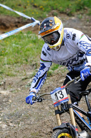 LEOGANG, AUSTRIA - JUN 12: UCI Mountain bike world cup. Fabien Barel (FRA) at the downhill final race on June 12, 2011 in Leogang, Austria.