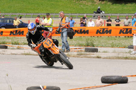 disabled sports: TAXENBACH, AUSTRIA - JUN 5: Supermoto trophy race. Famous disabled sports athlete Robert Friedrich at the exhibition race on June 5, 2011 in Taxenbach, Austria.