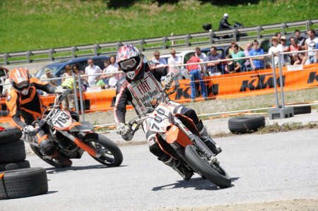 mud slide: TAXENBACH, AUSTRIA - JUN 5: Supermoto trophy race. Participants at the final race on June 5, 2011 in Taxenbach, Austria.
