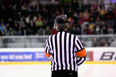 ZELL AM SEE, AUSTRIA - FEB 22: Austrian National League. Referee Vedran Krcelic. Game EK Zell am See vs. VEU Feldkirch (Result 3-1) on February 22, 2011 at hockey rink of Zell am See