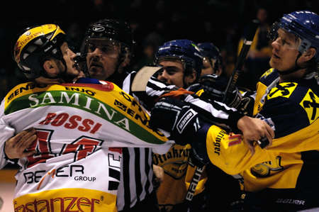 bodycheck: ZELL AM SEE, AUSTRIA - FEB 22: Austrian National League. Jari Suorsa and Michael Rossi in a brawl after the game. Game EK Zell am See vs. VEU Feldkirch (Result 3-1) on February 22, 2011 at hockey rink of Zell am See