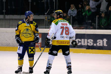 bodycheck: ZELL AM SEE, AUSTRIA - FEB 22: Austrian National League. Remi Royer instigating fight at the end of the game. Game EK Zell am See vs. VEU Feldkirch (Result 3-1) on February 22, 2011 at hockey rink of Zell am See Editorial