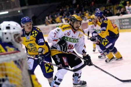 bodycheck: ZELL AM SEE, AUSTRIA - FEB 22: Austrian National League. Scoring chance for Feldkirch. Game EK Zell am See vs. VEU Feldkirch (Result 3-1) on February 22, 2011 at hockey rink of Zell am See Editorial