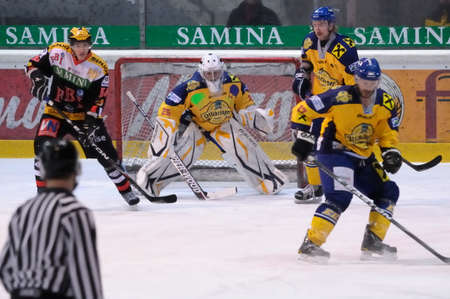 bodycheck: FELDKIRCH, AUSTRIA - FEB 24: Austrian National League. Scoring chance for Feldkirch. Game VEU Feldkirch vs. EK Zell am See (Result 6-0) on February 24, 2011 at hockey rink of Feldkirch