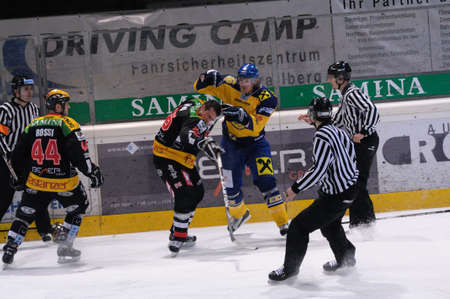 bodycheck: FELDKIRCH, AUSTRIA - FEB 24: Austrian National League. Fight between Jari Suorsa and Marco Ferrari. Game VEU Feldkirch vs. EK Zell am See (Result 6-0) on February 24, 2011 at hockey rink of Feldkirch