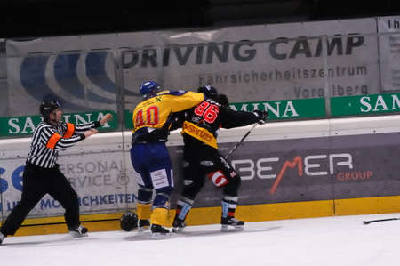 FELDKIRCH, AUSTRIA - FEB 24: Austrian National League. Fight between Jari Suorsa and Marco Ferrari. Game VEU Feldkirch vs. EK Zell am See (Result 6-0) on February 24, 2011 at hockey rink of Feldkirch