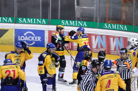 bodycheck: ZELL AM SEE, AUSTRIA - FEB 22: Austrian National League. One of many fights in penalty filled game. Game EK Zell am See vs. VEU Feldkirch (Result 3-1) on February 22, 2011 at hockey rink of Zell am See