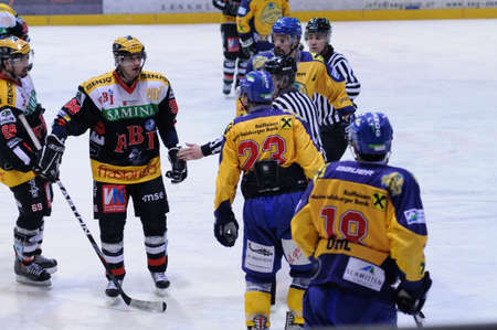bodycheck: ZELL AM SEE, AUSTRIA - FEB 22: Austrian National League. Ullrich of EKZ trying to instigate fight. Game EK Zell am See vs. VEU Feldkirch (Result 3-1) on February 22, 2011 at hockey rink of Zell am See Editorial