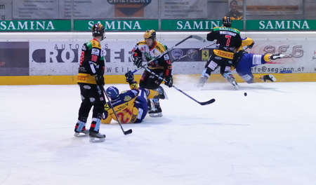 bodycheck: ZELL AM SEE, AUSTRIA - FEB 22: Austrian National League. Game gets chippy as the score is out of hand. Game EK Zell am See vs. VEU Feldkirch (Result 3-1) on February 22, 2011 at hockey rink of Zell am See Editorial