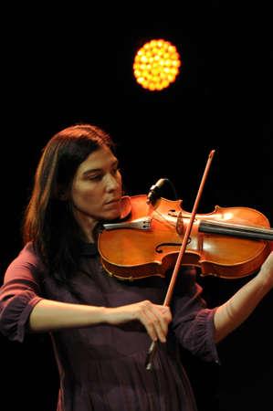 violin player: SAALFELDEN, AUSTRIA - AUG 28: Jazz Celebrity Jessica Pavone performing at Jazzfestival Saalfelden at Congresscenter Saalfelden, Austria.  Editorial