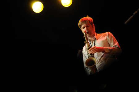 saalfelden: SAALFELDEN, AUSTRIA - AUG 28: Daniel Erdmann of the Band Das Kapital performing at Jazzfestival Saalfelden at Congresscenter Saalfelden, Austria.  Editorial