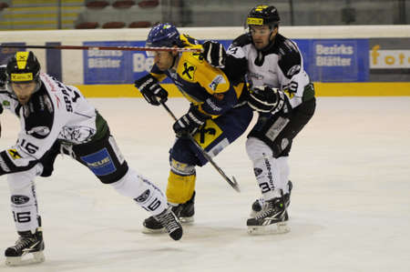 ec: ZELL AM SEE; AUSTRIA - JAN 14: Austrian National League. Bernhard Fechtig number 93 of EC Dornbirn (white Jersey) is blocking Stephan Uhl number 18 of Zell am See, who is forechecking Stefan Spannring number 16 of EC Dornbirn. Game between EK Zell am See