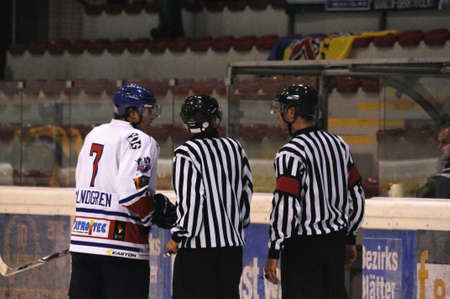 linesman: ZELL AM SEE; AUSTRIA - OCT 2: Austrian National League. Big discussion between the referee and ATSE Graz. Game between EK Zell am See and ATSE Graz (Result 2-3) on October 2, 2011 in Zell am See Editorial