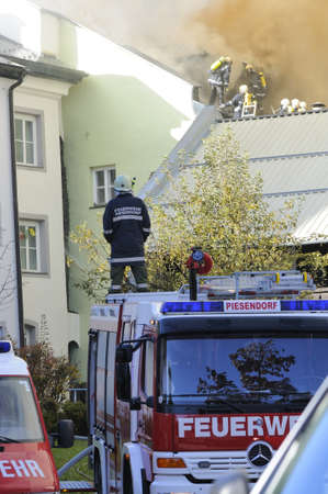 ZELL AM SEE; AUSTRIA - OCT 31: Firefighters attempt to extinguish a big fire in the centre of Zell am See on October 31, 2011 in Zell am See. Stock Photo - 12271765