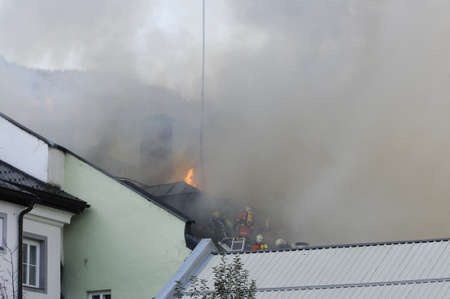 ZELL AM SEE; AUSTRIA - OCT 31: Firefighters attempt to extinguish a big fire in the centre of Zell am See on October 31, 2011 in Zell am See. Stock Photo - 12271725