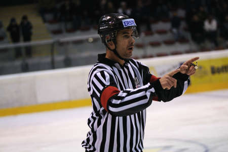 warns: ZELL AM SEE; AUSTRIA - SEPT 24: Austrian National League. The referee warns two players. Game EK Zell am See vs EHC Lustenau (Result 1-8) on September 24, 2011 in Zell am See.