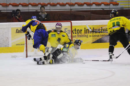 ZELL AM SEE; AUSTRIA - SEPT 24: Austrian National League. A player of Lustenau (yellow jersey) blocks a player of EKZ. Game EK Zell am See vs EHC Lustenau (Result 1-8) on September 24, 2011 in Zell am See. Stock Photo - 12271727