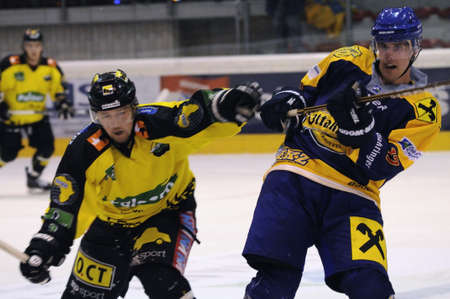 ZELL AM SEE; AUSTRIA - SEPT 24: Austrian National League. A player of Lustenau (yellow jersey) and a player of EKZ fighting for every inch on the ice. Game EK Zell am See vs EHC Lustenau (Result 1-8) on September 24, 2011 in Zell am See. Stock Photo - 12271751